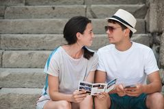 Tourist couple in love enjoying city sightseeing. Sitting on the stairs in the fortress Royalty Free Stock Photos