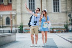 Tourist couple in love enjoying city sightseeing. Using map royalty free stock photos