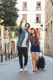 Tourist couple love walking in city. Royalty Free Stock Photo