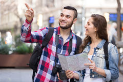Tourist couple with map in the city Stock Photo