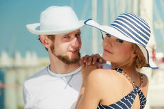 Tourist couple in marina against yachts in port Royalty Free Stock Photos