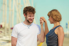 Tourist couple in marina against yachts in port Royalty Free Stock Photo