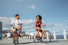 Tourist couple moving around the city on bicycles stock images