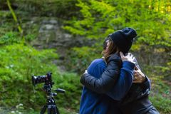 Tourist couple outdoor. Tourist couple happy hugging each other, their camera on tripod Stock Image