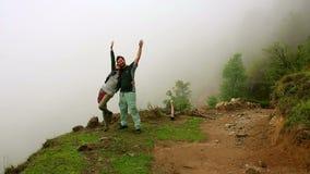 Tourist couple posing on top of himalayas mountain stock video footage