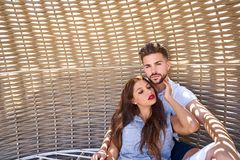 Tourist couple relaxed inside a beach parasol Royalty Free Stock Image
