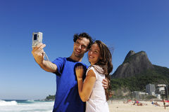 Tourist couple in Rio de Janeiro taking a photo Royalty Free Stock Photo