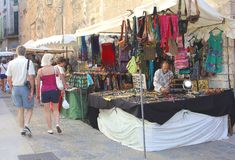 Shopping at the handicrafts market in Pollenca, Mallorca stock photos