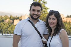 Tourist couple smile posing in Granada royalty free stock photography