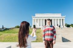 Tourist Couple Taking Pictures In Washington DC. A tourist couple taking pics in front of the Lincoln Memorial Stock Photos