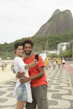 Tourist couple taking a self portrait in Rio de Janeiro Royalty Free Stock Image