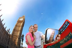 Tourist couple taking selfie against Big Ben in London, England, UK Stock Photos