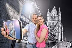 Tourist couple taking selfie against Tower Bridge in London, England, UK Stock Image