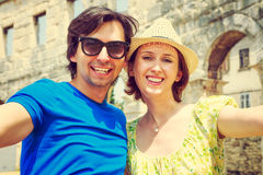 Tourist Couple Taking Selfie in Ancient Arena Royalty Free Stock Photo