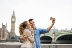 Tourist Couple taking selfie at Big Ben, London Stock Photography