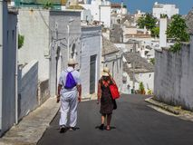 Tourist couple. Tourist travel couple in Alberobello, Italy Royalty Free Stock Image