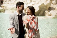 Tourist couple on travel by Trevi Fountain in Rome, Italy. Tourist young couple on travel by Trevi Fountain in Rome, Italy Stock Photography