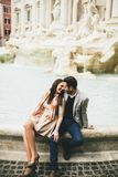 Tourist couple on travel by Trevi Fountain in Rome, Italy. Young tourist couple on travel by Trevi Fountain in Rome, Italy Stock Images
