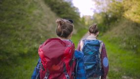 Tourist Couple Traveling, Walking In Nature. Tourist Couple Traveling, Walking With Backpacks On Summer Weekend, Enjoying Nature Of Mountains stock video footage