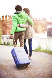 Tourist couple walking in city with suitecase Stock Photo