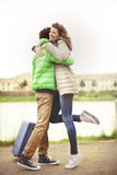 Tourist couple walking in city with suitecase Royalty Free Stock Images