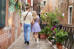 Tourist couple walking in romantic city Royalty Free Stock Images