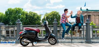 Tourist couple making stop during Vespa excursion in Berlin Royalty Free Stock Images