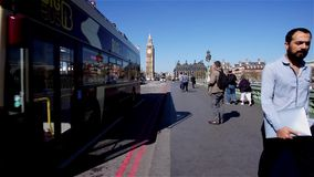 Tourist crossing Westminster Bridge stock video footage