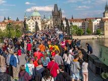 Tourist crowd on Charles Bridge in Prague Stock Photo