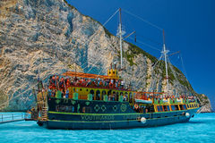 Tourist Cruise Boat in Navagio Bay, Zakyntos Island, Greece Royalty Free Stock Image