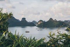 Free Tourist Cruise Ship Standing Among Limestone Mountains In Halong Bay, Vietnam Royalty Free Stock Photo - 154687605