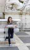 Tourist.Cute girl with map and camera in roma Stock Image