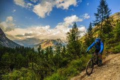 Tourist cycling in Cortina d`Ampezzo, stunning rocky mountains o Royalty Free Stock Photography