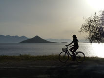 Tourist cycling in the evening Royalty Free Stock Photos
