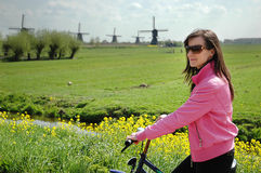 Tourist cycling. Cycling tourists visiting the windmills of Kinderdijk Royalty Free Stock Images