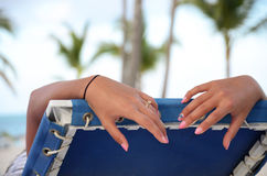Tourist in a deckchair on the beach Royalty Free Stock Photography