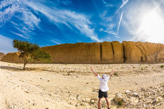 The tourist is delighted with desert Royalty Free Stock Images