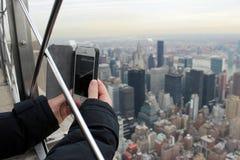 Tourist, der ein Foto in New York City macht Stockfoto