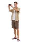 Tourist, der Fotos von den Punkten von Zinsen bildet Stockbilder
