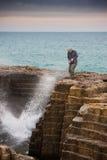 Tourist, der gespritzt erhält Lizenzfreie Stockbilder