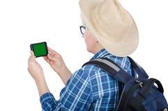 Tourist, der Handy mit Farbenreinheitsschlüsselschirm betrachtet Stockfotos