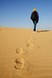 Tourist in desert. Tourist in the endless desert in Autumn Royalty Free Stock Image