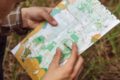 Tourist determine the route map and compass Stock Photo