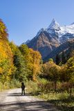 Tourist in Dombay-Ulgen valley royalty free stock photos