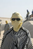 Tourist dressed like bedouin with sunglasses Stock Image