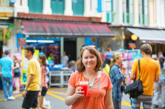 Tourist drinking watermelon juice in Singapore Stock Photography