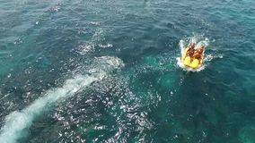 Tourist driving Banana boat water Sport, with blue sky background. In Nusa Penida, snorkeling diving, banana boat, water sport, parasailing, jet sky, fly fish stock video footage
