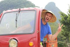 Tourist driving a tuk-tuk in Asia.  royalty free stock images