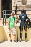 Tourist with a dummy knight in Rhodes Old Town fortress. Rhodes. Stock Photos