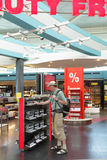 Tourist in duty free shop Royalty Free Stock Image